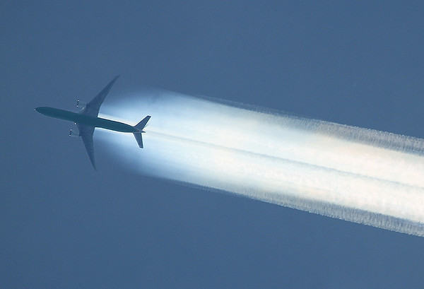 EVA Air Boeing 777-300 High above Frankfurt am Main (Rhein-Main AB) (FRA / FRF / EDDF) Germany, June 3, 2010   There seems to be a lot of humidity up there.....the contrails are almost hidden among all the vapour.