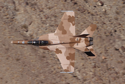 USA - Navy Boeing F/A-18F Super Hornet   Off-Airport - Rainbow Canyon area USA - California, November 23, 2010   165679 / NJ-101 (cn 1516/F018)  Wow!! A Super Hornet of VFA-122 'Flying Eagles' out of NAS Leemoore, since this day I call them the low Flying Eagles! This Hornet was very low and fast in the canyon and shortly afterwards put on the afterburner and climbed into the blue California sky. The camouflage fits well in this surrounding. Believe me, it was the experience of my trip to the States! Some photographers go to Wales for this stuff, I prefer the more sunny and warm conditions in California.  Copyright Gerhard Plomitzer