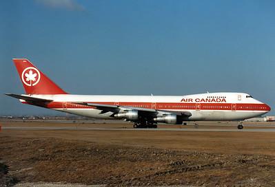 Air Canada Boeing 747-133  Toronto - Lester B. Pearson Intl. (Malton) (YYZ / CYYZ) Canada - Ontario, February 1989 Reg: C-FTOC Code: 303 Cn: 20015/144 Classic 747 on taxiway Lima.