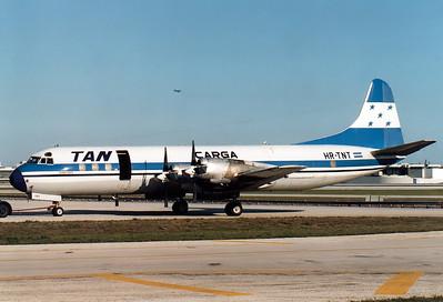 TAN Carga - Transportes Aereos Nacionales Lockheed L-188A(F) Electra  Miami - International (Wilcox Field / 36th Street / Pan American Field) (MIA / KMIA) USA - Florida, April 1989 Reg: HR-TNT  Cn: 1060 Often visitor at Miami.