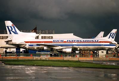 Rich International Airways Lockheed L-1011-385-1 TriStar 1  Miami - Intl.  (MIA / KMIA) USA - Florida, November 1993 Reg: N303EA  Cn: 193A-1004 After a heavy rainshower the Florida sunshine is back again.