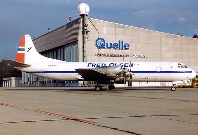 Fred Olsen Lockheed L-188A(F) Electra  Nuremberg (NUE / EDDN) Germany, June 1990 Reg: LN-FOG  Cn: 1143 Resting for the night schedule on a warm summer evening.